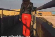 brunette-in-red-leather-pants-and-black-leather-jacket