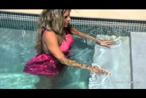 leslie-ann-heads-to-the-pool-in-her-pink-dress