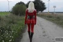 blonde-fetish-girl-in-red-latex-catsuit-and-6-inch-boots