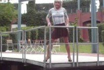 in-miniskirt-with-stockings-and-high-heels-erotic-walk-in-city-park